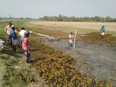Figure 4 Canal demarcation with red flags going on by the community to resolve of land conflicts