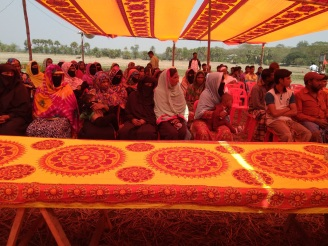 Photo 2-Women with veils attended in the launching ceremoney and seated in equal position with men by breaking the barriers of conservetiveness